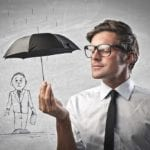 Businessman protecting with a 150x150 - Managed WordPress Support
